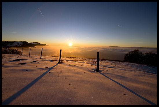 Lumière du soleil couchant depuis les crêtes du Salève